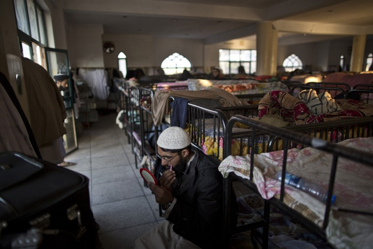 In this Tuesday, Jan. 27, 2015 photo, a Pakistani student of a madrassa, or Islamic school, uses tweezers to groom his beard, at the seminary dorms on the outskirts of Islamabad, Pakistan. Thereís no exact number of madrassas in Pakistan but estimates put the number in the tens of thousands. They provide food, housing and a religious education to students from around the country. Many teach both male and female students.(AP Photo/Muhammed Muheisen)