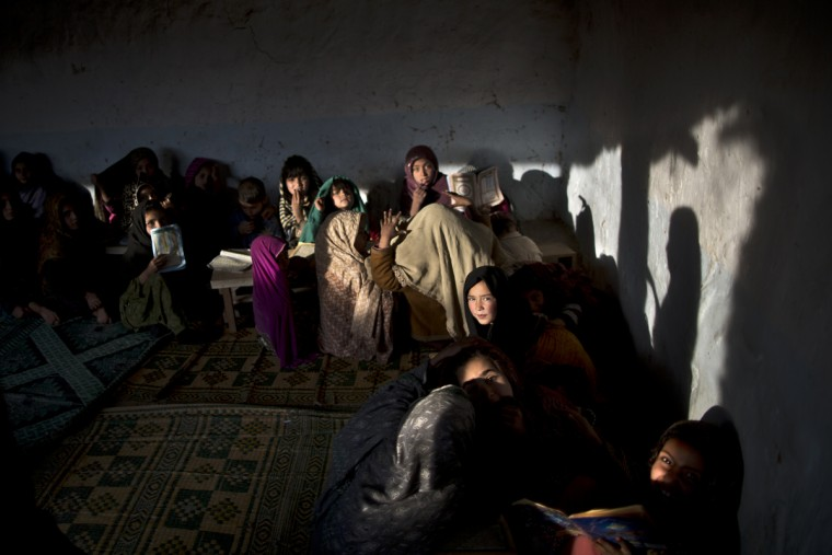 In this Monday, Jan. 19, 2015 photo, internally displaced Pakistani children from tribal areas attend madrassa, or Islamic school, set up in a mosque on the outskirts of Islamabad, Pakistan. Thereís no exact number of madrassas in Pakistan but estimates put the number in the tens of thousands. They provide food, housing and a religious education to students from around the country. Many teach both male and female students. (AP Photo/Muhammed Muheisen)
