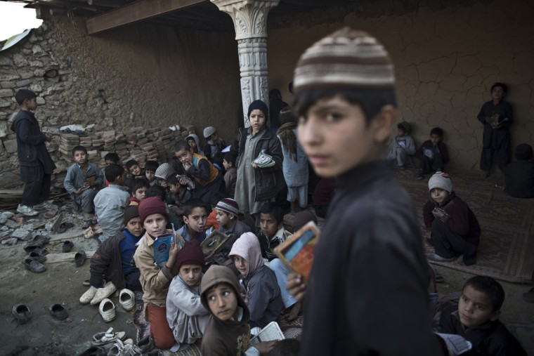 In this Thursday, Jan. 29, 2015 photo, Afghan refugees and internally displaced Pakistani children from tribal areas gather in a mosque which is under construction to attend madrassa, or Islamic school, on the outskirts of Islamabad, Pakistan. Thereís no exact number of madrassas in Pakistan but estimates put the number in the tens of thousands. They provide food, housing and a religious education to students from around the country. Many teach both male and female students.(AP Photo/Muhammed Muheisen)