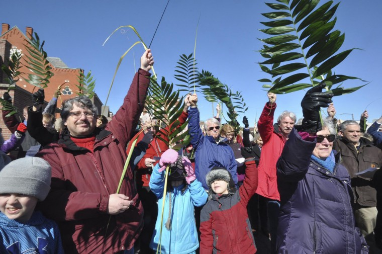 Four area churches from different denominations mark Palm Sunday with a community-wide blessing of the palms in the parking lot at the intersection of Fenn and Pearl Streets in Pittsfield, Mass. on Sunday, March, 29, 2015. All of the palms are Eco-Palms which were sustainably grown and harvested in Guatamala and Mexico. Palm Sunday begins the Christian season of Holy Week. (AP Photo/The Berkshire Eagle, Gillian Jones)