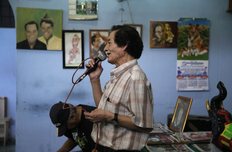 In this Feb. 27, 2015 photo, inmate Mauro Garcia, 65, sings a Peruvian folk song at Lurigancho men's prison in Lima, Peru. The prison system offers dozens of art-based workshops and therapeutic sessions for the elderly prisoners. (AP Photo/Martin Mejia)