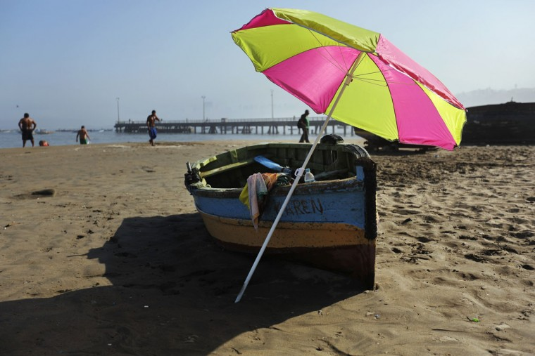 An umbrella is seen resting in a fishing boat at the Chorrillos cove in Lima, Peru, Thursday, March 26, 2015. (AP Photo/Rodrigo Abd)
