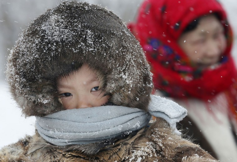 In this photo taken on Sunday, March 15, 2015, a Nenets boy attends the Reindeer Herder's Day holiday in the city of Nadym, in Yamal-Nenets Region, 2500 kilometers (about 1553 miles) northeast of Moscow, Russia. Some participants traveled hundreds of kilometers (miles) across the frozen tundra to attend the competition in the northern Siberian region, which has more than half of its territory above the Arctic Circle. (AP Photo/Dmitry Lovetsky)