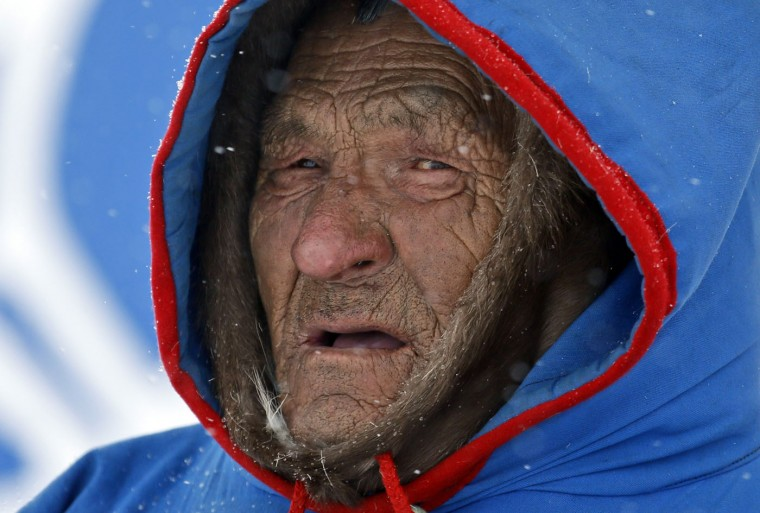 In this photo taken on Sunday, March 15, 2015, an elderly Nenets man attends the Reindeer Herder's Day in the city of Nadym, in Yamal-Nenets Region, 2500 km (about 1553 miles) northeast of Moscow, Russia. The Reindeer Herder's Day is celebrated annually in Russiaís Yamal-Nenets region in the Arctic and for the Nenets people, it offers a chance to show their prowess in wrestling, high jumps and other traditional sports, but, above all, reindeer races. (AP Photo/Dmitry Lovetsky)