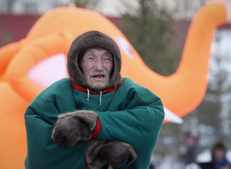 In this photo taken on Saturday, March 14, 2015, a Nenets elderly man watches competition during the Reindeer Herder's Day holiday in the city of Nadym, in Yamal-Nenets Region, 2500 km (about 1553 miles) northeast of Moscow, Russia. The Reindeer Herder's Day is celebrated annually in Russiaís Yamal-Nenets region in the Arctic and for the Nenets people, it offers a chance to show their prowess in wrestling, high jumps and other traditional sports, but, above all, reindeer races. (AP Photo/Dmitry Lovetsky)