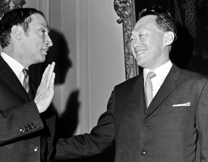 In this Jan. 7, 1969, file photo, then Singapore's Prime Minister Lee Kuan Yew, right, talks with then Prime Minister of Canada Pierre Trudeau, left, before the opening session of the Commonwealth Prime Ministers conference at Marlborough House, in London. Lee brought prosperity to Singapore with an authoritarian system designed to outlast him, but that legacy may be ill-suited for the 21st-century challenges facing the tropical city-state. One of the last of a generation of Southeast Asian strongmen, Lee died Monday, March 23, 2015, at age 91. (AP Photo/File)