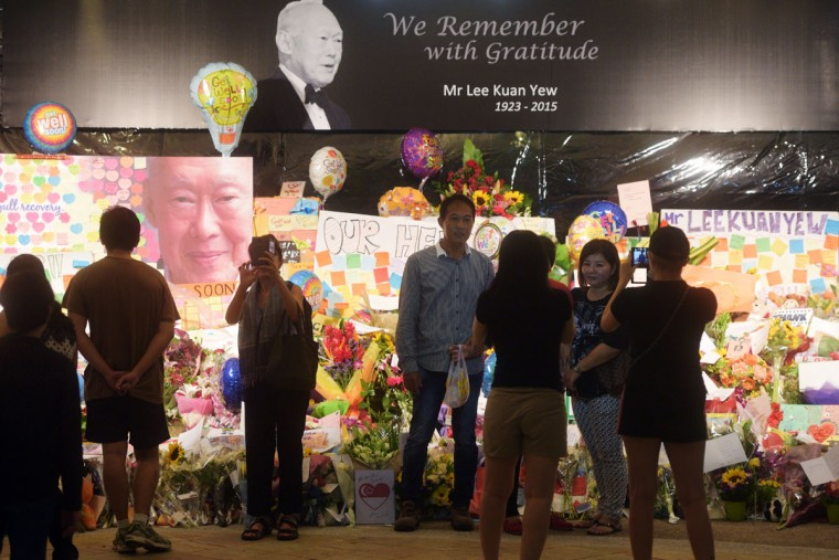 """Visitors take pictures of themselves in an area set aside for tributes to former Singapore Prime Minister Lee Kuan Yew at the hospital where he passed away, Monday, March 23, 2015 in Singapore. Singaporeans wept and world leaders paid tribute Monday as the Southeast Asian city-state mourned the death of its founding father Lee Kuan Yew. The government announced that Lee """"passed away peacefully"""" several hours before dawn at Singapore General Hospital. He was 91. (AP Photo/Joseph Nair)"""