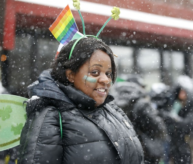 Shenetta Inmon sports a gay pride flag alongside her shamrock headwear as she waits for marchers to pass during the all-inclusive St. Pat's For All parade in the Sunnyside, Queens neighborhood of New York, Sunday, March 1, 2015. The parade, which embraces diversity, is considered an alternative to New York City's official March 17, St. Patrick Day parade. (AP Photo/Kathy Willens)