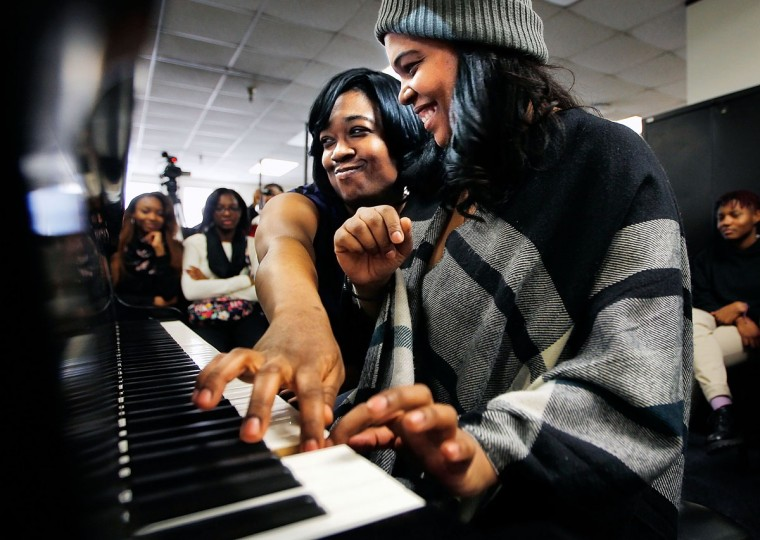 Kimberly, left, and Michelle Cann, the Cann Sisters Piano Duo, battle for the last note Tuesday, Feb. 3, 2015, while playing an improvisational piece for students in the CAPA Piano Lab at Overton High School in Memphis. In addition to their educational outreach, the sisters -- who usually play on separate pianos -- will be performing Wednesday evening at the University of Memphis Harris Concert Hall, part of this year's Concerts International season. (AP Photo/The Commercial Appeal, Jim Weber)