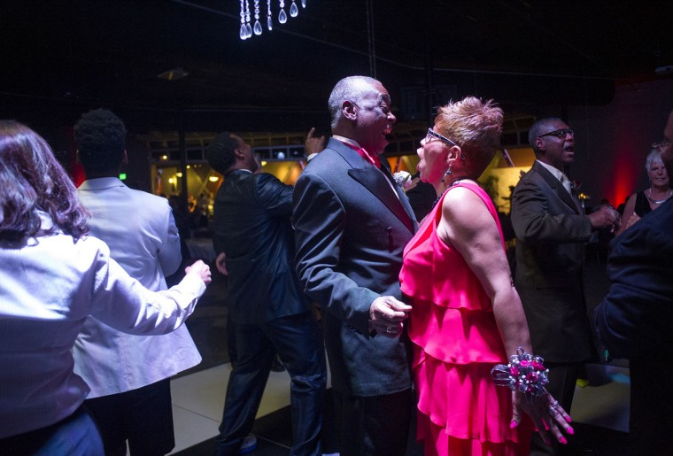 Guilford and Lee Ann Forney enjoy dancing during Senior Prom at Overcoming Believers Church Friday, March 27, 2015, in Knoxville, Tenn. The celebration for the older set included a red carpet, paparazzi, and live entertainment. (AP Photo/Knoxville News Sentinel, Jessica Tezak)