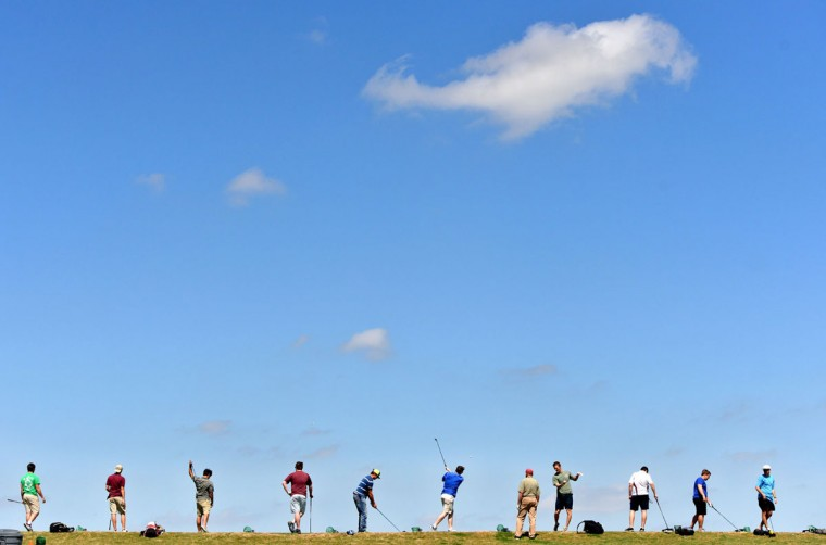 Golfers take aim down range as they swing away at the Texas A&M University Golf Course driving range in College Station, Texas, Tuesday, March 24, 2015. (AP Photo/College Station Eagle, Sam Craft)