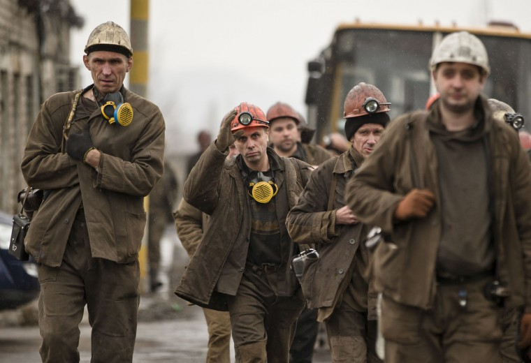 Ukrainian coal miners arrive at the Zasyadko mine, to assist in the search for bodies of colleagues following an explosion, in Donetsk, Ukraine, Wednesday, March 4, 2015. (AP Photo/Vadim Ghirda)