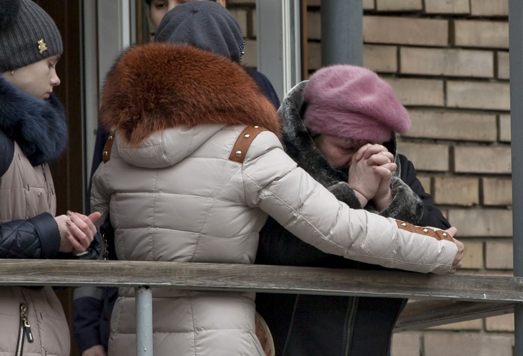 A relative of a miner cries outside the headquarters of the Zasyadko mine in Donetsk, Ukraine, Wednesday, March 4, 2015. An explosion ripped through a coal mine before dawn Wednesday in war-torn eastern Ukraine, killing at least one miner and trapping more than 30 others underground, rebel and government officials said. (AP Photo/Vadim Ghirda)