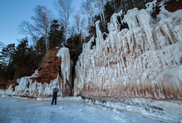 A person explores an ice cave at the Apostle Islands National Lakeshore on Lake Superior, Friday, Feb. 27, 2015, near Bayfield, Wis. (Zbigniew Bzdak/Chicago Tribune)