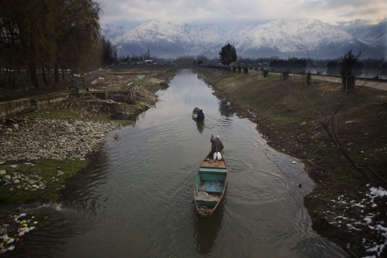 Kashmiri fishermen row their boats through a canal on their way home after working in Dal Lake in Srinagar, in Indian-controlled Kashmir, on Tuesday, March 10, 2015. Dal Lake, famous for its natural beauty and a popular destination for international and domestic tourists, has shrunk in the past two decades. According to local reports, it has decreased by more than half to 11 square kilometers and lost 12 meters in depth. (AP Photo/Dar Yasin)