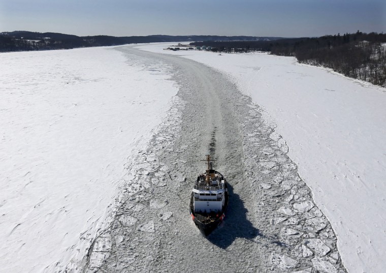 U.S. Coast Guard cutter Sturgeon Bay breaks ice in the shipping channel on the Hudson River in Catskill, N.Y., about 95 miles (150 km) north of New York City, on Friday, Feb. 27, 2015. With the prolonged cold winter weather, the Coast Guard has been busy clearing shipping lanes. (AP Photo/Mike Groll)