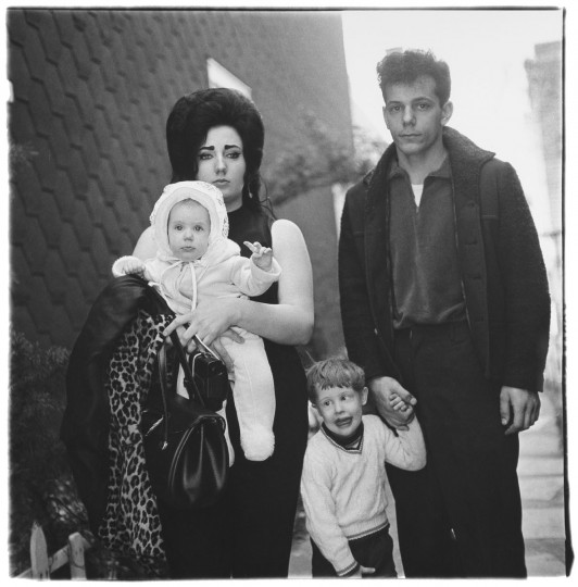 """""""A Young Brooklyn family going on a Sunday outing, N.Y.C., 1966."""" (Diane Arbus)"""