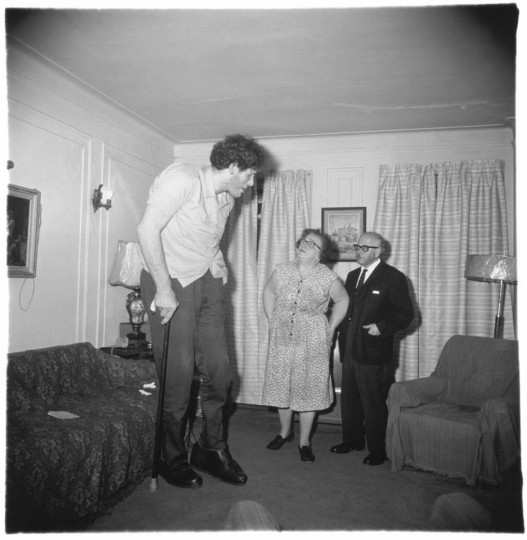 """""""A Jewish giant at home with his parents in the Bronx, N.Y., 1970. (Diane Arbus)"""