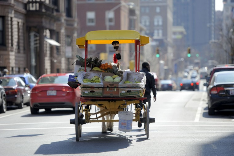 Baltimore's Arabbers, who peddle their wares through the city streets via horse and wagon, are among the city's more unique (though endangered) transportation traditions. The salesmen have been delivering fruit, produce and other goods door-to-door since the 1800s. (Kim Hairston/Baltimore Sun)