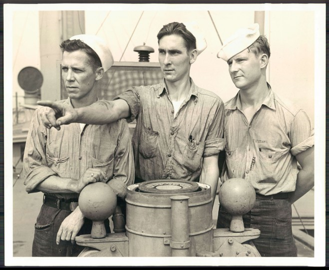 From left to right: Fireman Charles Pollard of Dundalk, Fireman William H. Horney of N. Potomac, and Seaman Vincent O'Bryan of Elkridge. These men served aboard the USS Warfield while she was in service on the Atlantic. (Official U.S. Navy photograph, 1945)