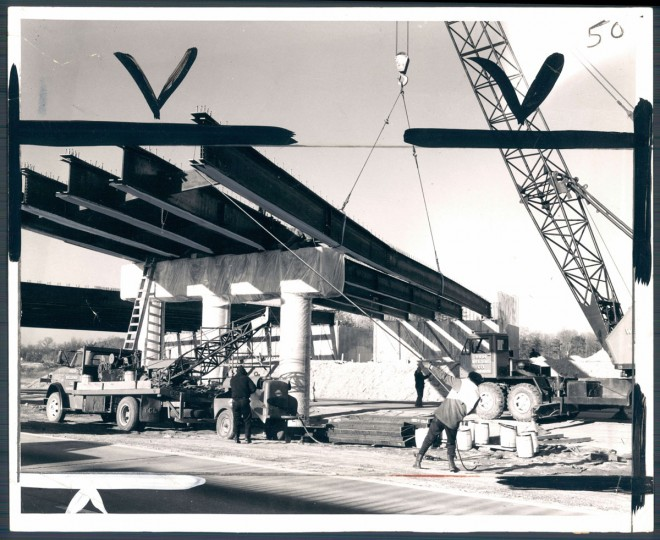 "A steel girder is put in place for a bridge over the Beltway. The Bethlehem Steel Corporation, which makes the ""weathering"" steel, says the no-paint steel will save the state ""many dollar in pain maintenance."" (Baltimore Sun archives)"