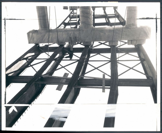 "An engineer starts preliminary design work for metal decking on one of four bridges that will carry Interstate 95 over the Beltway near Arbutus. The steel girders are made of new ""weathering"" steel that needs no painting. The steel forms its own brown oxide coating. (Baltimore Sun archives)"