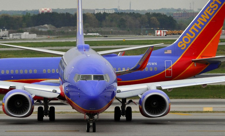"The Baltimore region's one and only major airport, BWI Thurgood Marshall Airport in Anne Arundel Co., has had a bit of a rockstar couple years. It's expanded its international reach with new routes from its main carrier, Southwest Airlines, and has introduced new technologies to better serve its more than 61,000 daily customers under its ""easy come, easy go"" mantra. Passenger volume stood at 22.31 million in 2014, slightly down from the 22.5 million seen in 2013. But airport officials see that number continuing to grow, and Southwest executives have been bullish about growth, too. Who needs a vacation?--Kevin Rector (Kim Hairston/Baltimore Sun)"