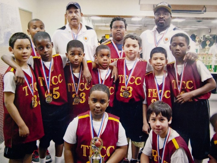 Essien Ture, second row far right, poses for a photo circa 2009 with his TRCC (Tucker Road Community Center) basketball team. Photo Provided.