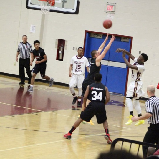 Essien Ture takes a shot in a game this past basketball season. Photo Provided.