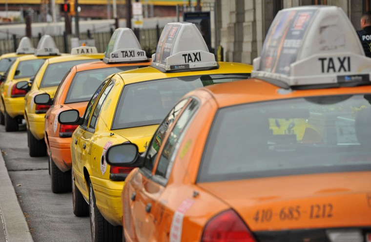 Yellow/Checker Cab has a fleet of approximately 600 taxis in Baltimore, made up of Crown Vics and Dodge minivans, plus some Prius hybrids. If you can hail one, this might be one of the more convenient and affordable ways to get around town. At Penn Station or BWI, you can wait at the designated area for the next one in line. The company operates Yellow, Checker and Sun Cabs in Baltimore City and Jimmy's Taxi in Baltimore County. (Amy Davis/Baltimore Sun)