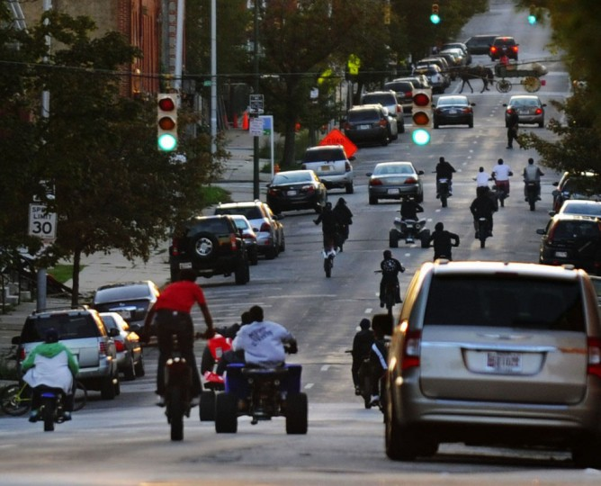 "OK, this isn't exactly a sanctioned -- or even -- legal way to get around downtown, but rebel crews of teenagers do it, nonetheless. As shown in the 2013 documentary ""12 O'Clock Boys"" (so named for the position of the bikes as the rider pops a vertical wheelie), dirt bike gangs have been known to take over city streets Wild West-style, with very little attention paid to traffic laws or stop lights. If you hear the recognizable buzz coming at you in the distance, get out of the way fast. Maybe flag down a passing pirate ship. (Kenneth K. Lam/Baltimore Sun)"