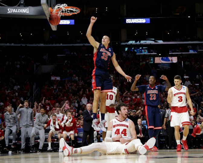 Wisconsin forward Frank Kaminsky (44) reacts after being fouled by Arizona center Kaleb Tarczewski (35) during the first half of a college basketball regional final in the NCAA Tournament in Los Angeles. (Jae C. Hong/Associated Press)