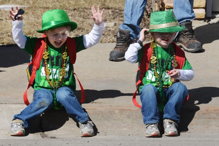 Twins Conor and Declan Pauley, 3-1/2, of Volo, Ill., attend the St. Patrick's Day Parade in Lake Villa, Ill. (Daniel White/Daily Herald/Associated Press)