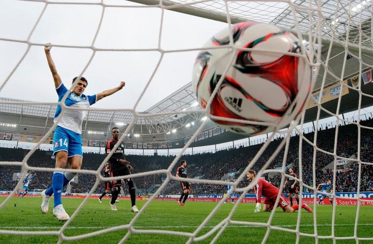 Eugen Polanski (L) of Hoffenheim scores his team's second goal during the Bundesliga match between 1899 Hoffenheim and Hamburger SV at Wirsol Rhein-Neckar-Arena in Sinsheim, Germany. (Matthias Hangst/Getty Images)