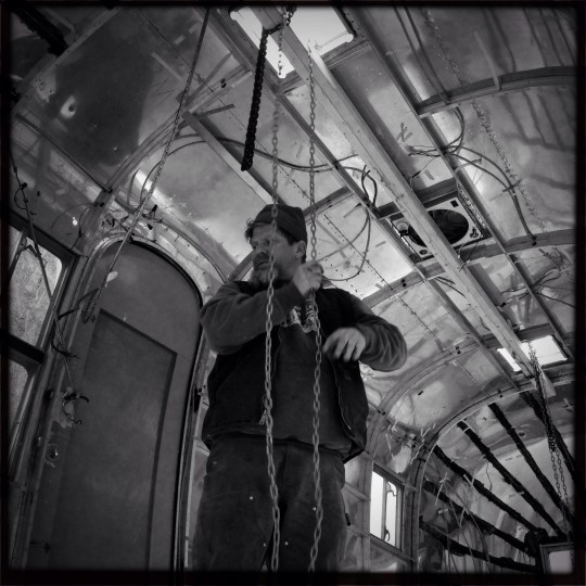 """The interior shell of """"Fred"""" is lowered into place by Frank Yensan. (Christopher T. Assaf/Baltimore Sun)"""