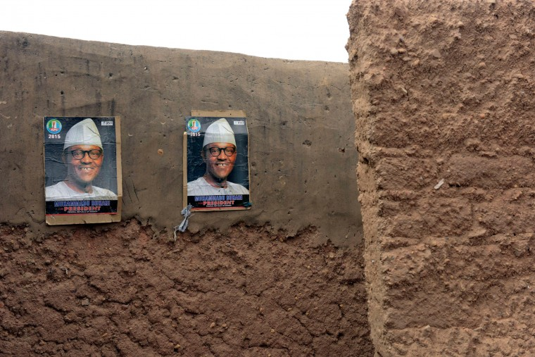 Posters of main opposition All Progressives Congress (APC) candidate Mohammadu Buhari are displayed on the wall of a mud house in Daura, Katsina State, during presidential elections . Voting in Nigeria's general election has been extended to March 29 in 300 out of 150,000 polling stations, the electoral commission said, after technical glitches marred polling nationwide. (Pius Utomi Ekpei/AFP-Getty Images)