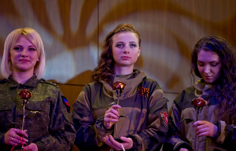 Russia-backed female rebel fighters stand on stage after taking part in a beauty contest involving women from the main separatist battalions in Donetsk, Ukraine. Self-proclaimed authorities in the rebel-held Donetsk held a beauty pageant for female rebel fighters on the eve of March 8, a women's day widely celebrated throughout the former Soviet Union. (Vadim Ghirda/Associated Press)