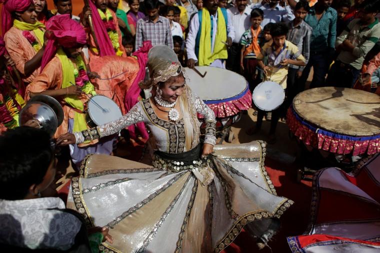 A woman dances during a religious procession on Ram Navami festival in New Delhi, India, Saturday. Ram Navami marks the birth of Hindu God Rama. (Altaf Qadri/Associated Press)