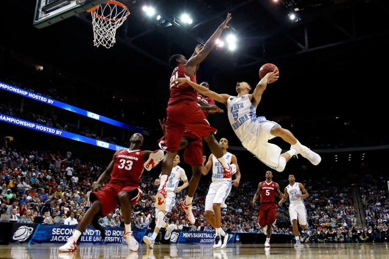 Marcus Paige #5 of the North Carolina Tar Heels puts up a shot as he is defended by Manuale Watkins #21 of the Arkansas Razorbacks in the second half during the third round of the 2015 NCAA Men's Basketball Tournament at Jacksonville Veterans Memorial Arena on March 21, 2015 in Jacksonville, Florida. (Photo by Kevin C. Cox/Getty Images)