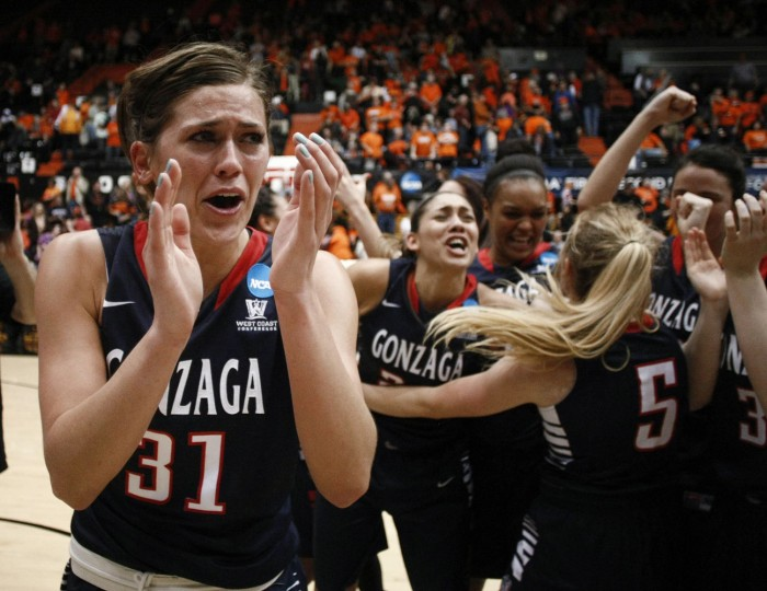 Gonzaga's Elle Tinkle joins her teammates in celebrating a 76-64 win over Oregon State in a college basketball game in the second round of the NCAA women's tournament in Corvallis, Ore., Sunday, March 22, 2015. (AP Photo/Timothy J. Gonzalez)