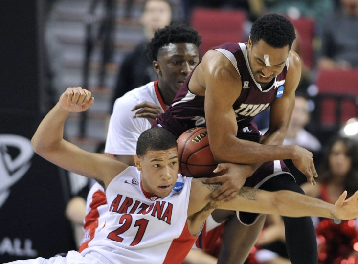 Texas Southern forward Malcolm Riley, right, battles for the ball with Arizona forward Brandon Ashley during the second half in the second round of the NCAA college basketball tournament in Portland, Ore., Thursday, March 19, 2015. Watching in the background is Arizona forward Stanley Johnson. (AP Photo/Greg Wahl-Stephens)