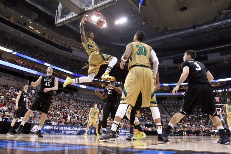 Notre Dame's Demetrius Jackson (11) throws down a dunk during the first half of an NCAA college basketball third round game against Butler in Pittsburgh Saturday, March 21, 2015. Notre Dame won 67-64 in overtime. (AP Photo/Gene J. Puskar)