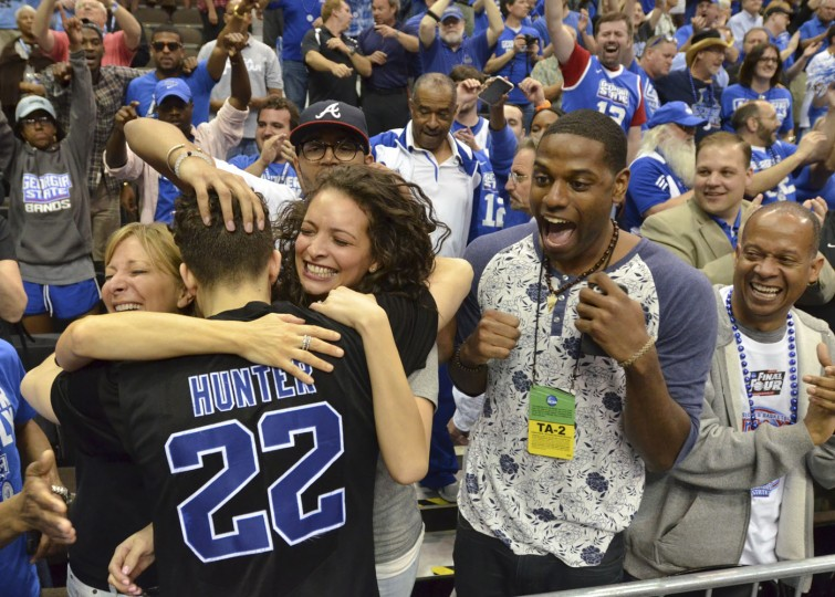 Georgia State's R.J. Hunter (22) celebrates with fans as he leaves the court after he made the game-winning shot against Baylor in the second round of the NCAA college basketball tournament, Thursday, March 19, 2015, in Jacksonville, Fla. Georgia State won 57-56. (AP Photo/Rick Wilson)
