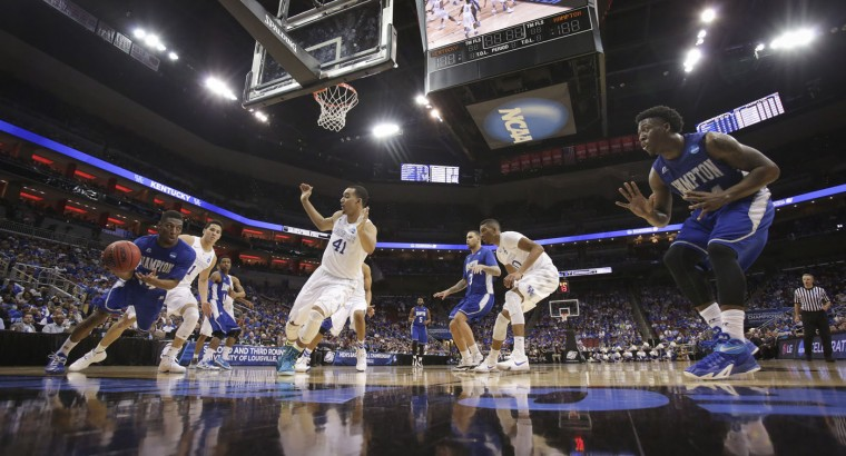 Hampton guard Brian Darden looks to pass to guard Reginald Johnson, right, during the second half of an NCAA tournament second round college basketball game against Kentucky, in Louisville, Ky., Friday, March 20, 2015. Kentucky won the game 79-56. (AP Photo/David Stephenson)