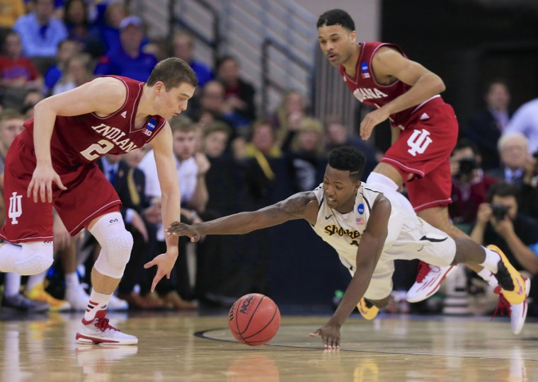 Indiana's Nick Zeisloft (2) and Wichita State's Zach Brown (1) go for a loose ball as Indiana's James Blackmon Jr. (1) looks on, rear right, during the first half of an NCAA tournament college basketball game in the Round of 64 in Omaha, Neb., Friday, March 20, 2015. (AP Photo/Nati Harnik)