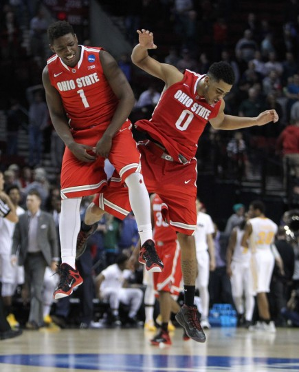 Ohio State guard D'Angelo Russell, right, celebrates with teammate Jae'Sean Tate after winning an NCAA tournament college basketball second round game against Virginia Commonwealth, Thursday, March 19, 2015, in Portland, Ore. Russell led Ohio State in scoring with 28 points as they won 75-72 in overtime. (AP Photo/Craig Mitchelldyer)