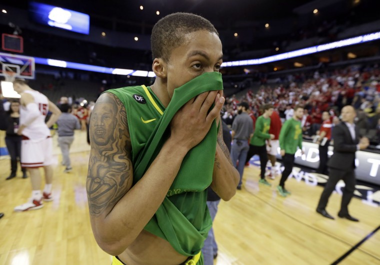 Oregon guard Joseph Young walks off the court after an NCAA college basketball tournament Round of 32 game against Wisconsin, Sunday, March 22, 2015, in Omaha, Neb. Wisconsin won 72-65. (AP Photo/Charlie Neibergall)