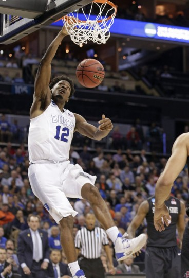 Duke's Justise Winslow (12) dunks against San Diego State during the second half of an NCAA tournament college basketball game in the Round of 32 in Charlotte, N.C., Sunday, March 22, 2015. (AP Photo/Nell Redmond)