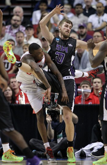 Utah guard Delon Wright, left, collides with Stephen F. Austin forward Tanner Clayton during the second half of an NCAA college basketball second-round game in Portland, Ore., Thursday, March 19, 2015. (AP Photo/Craig Mitchelldyer)