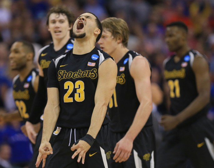 Wichita State's Fred VanVleet (23) reacts after hitting a three-point basket against Kansas during the first half of an NCAA tournament college basketball game in the Round of 32 in Omaha, Neb., Sunday, March 22, 2015. (AP Photo/Nati Harnik)